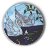 Picture of Arnie Garinger's stained glass work of art, Swans oval plaque.